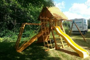 wooden playgrounds - swing sets - residential play sets - climbing - slide - Jungle Gyms Canada