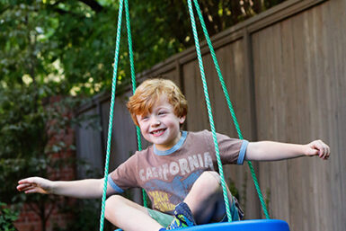 Swings - sky saucer swing - playgrounds - swing set - backyard play set equipment - Jungle Gyms Canada